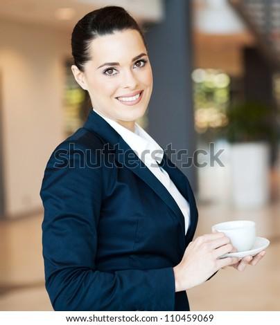 attractive modern businesswoman having coffee - stock photo