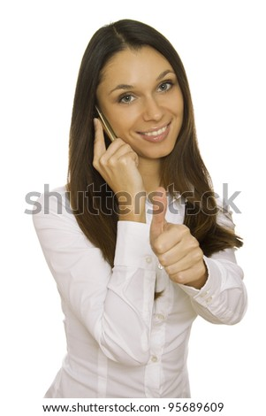 Attractive modern businesswoman talking on the phone. Thumb up. Isolated on a white background
