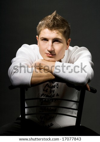 attractive modern man sitting on a chair