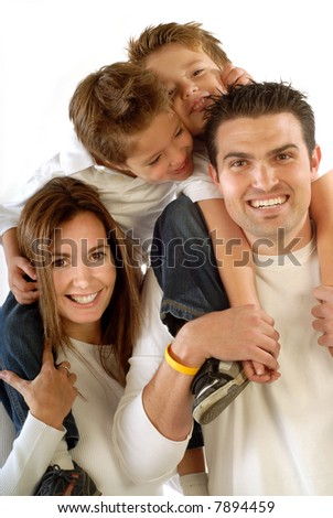 Attractive, modern young family hugging and laughing together - stock photo
