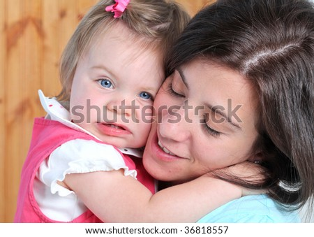Attractive mother and daughter portrait - stock photo