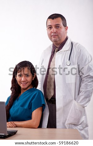 Attractive multi racial medical man and woman team