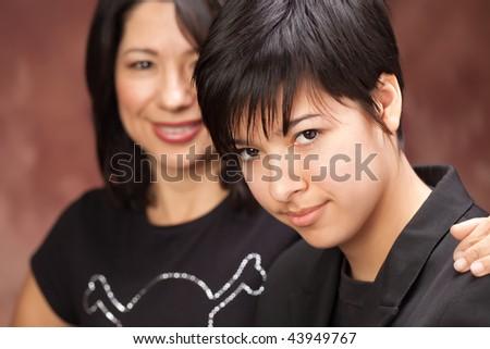 Attractive Multiethnic Mother and Daughter Studio Portrait. - stock photo