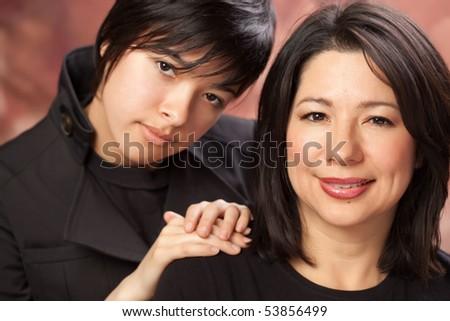 Attractive Multiethnic Mother and Daughters Studio Portrait. - stock photo