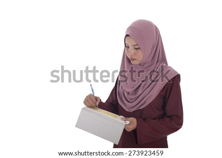 Attractive Muslim businesswoman signing cheque with white background. - stock photo