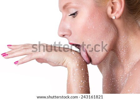 Attractive naked girl enjoys a spray with milk.Spa treatment for skin nutrition and moisturizing skin renewal. - stock photo