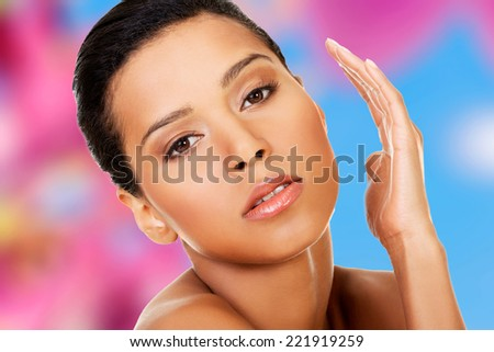 Attractive naked woman. Hands close to face. Closeup on face. - stock photo