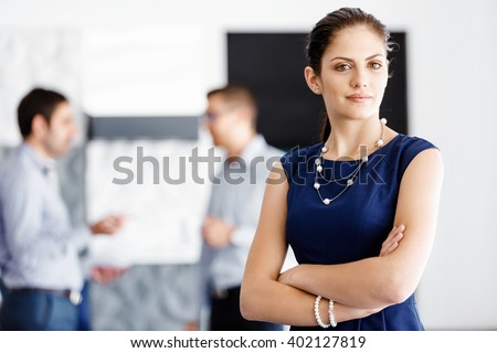 Attractive office worker standing - stock photo