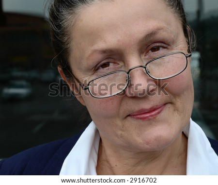 Attractive older businessman in her late fifties, smiling - stock photo