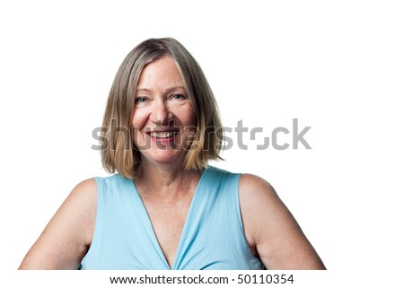 Attractive older woman in a traditional portrait - stock photo