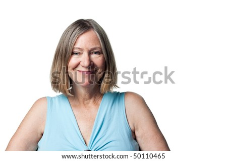 Attractive older woman smiles broadly and happily - stock photo