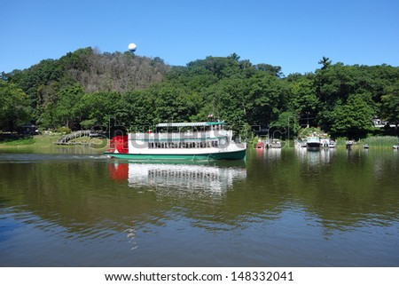 Attractive paddle wheel on the Kalamazoo River in Michigan - stock photo