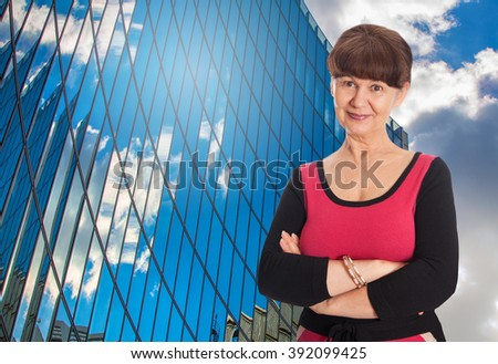 Attractive pension age good looking woman portrait. Business concept - stock photo