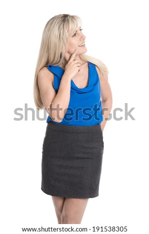 Attractive pensive mature woman in summer clothes looking sideways to text. - stock photo