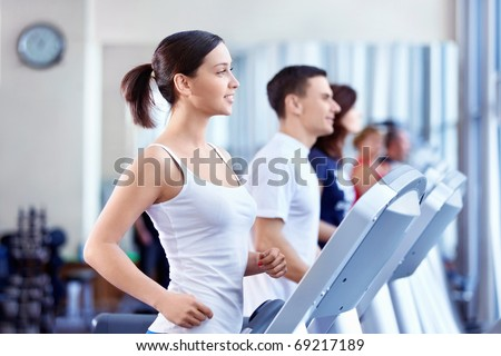 Attractive people on the treadmill - stock photo