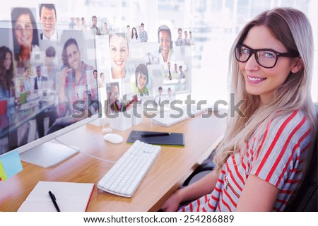 Attractive photo editor working on computer against handsome designer sit in his office - stock photo
