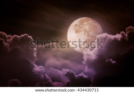 Attractive photo of a nighttime sky with clouds, bright full moon would make a great background. Beauty of nature. Vintage tone. The moon taken with my own camera, no NASA images used. - stock photo