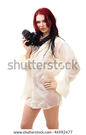 Attractive photographer in wet clothes standing isolated on white - stock photo