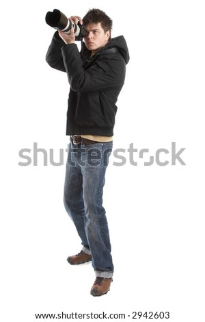 Attractive photographer with big zoom lens over white background - paparazzi