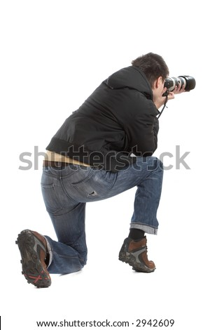 Attractive photographer with big zoom lens over white background - paparazzi - stock photo