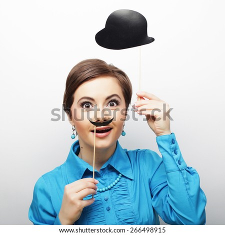 Attractive playful young woman ready for party - stock photo