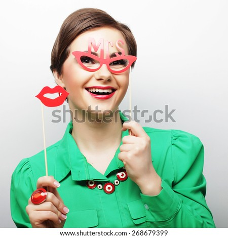 Attractive playful young woman ready for party - falce lips and glasses    - stock photo