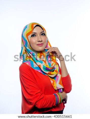 Attractive portrait of young muslim woman in head scarf smile - stock photo