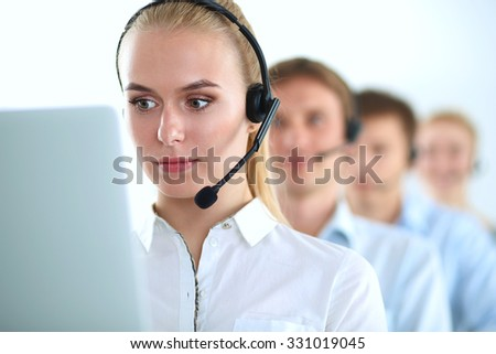 Attractive positive young businesspeople and colleagues in a call center office - stock photo