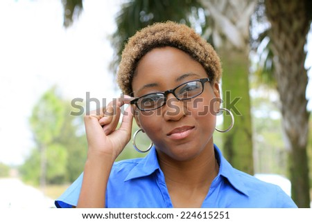 Attractive Professional African American Business Woman Person Black Hair Holding Glasses and Smiling - stock photo