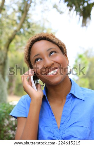 Attractive Professional African American Business Woman Person Black Hair on the Phone Talking and Laughing  - stock photo