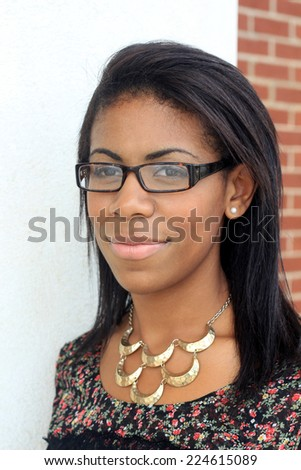 Attractive Professional African American Business Woman Person Black Hair Wearing Glasses and Smiling  - stock photo