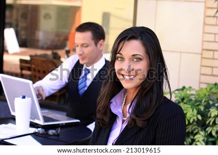 Attractive Professional Business Man and Woman Working On A Group Project in Front of A Computer and Drinking Coffee - stock photo