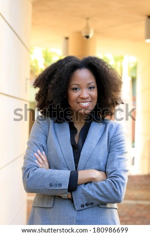 Attractive Professional Business Professional Smiling Arms Crossed Happy - stock photo