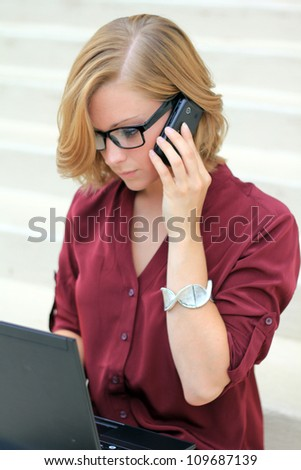 Attractive Professional Business Woman Frustrated, On the Phone and computer, and Looking Down - stock photo