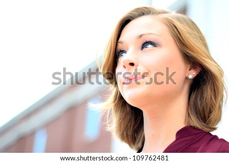 Attractive Professional Business Woman Looking Forward, Smiling Side Profile - stock photo