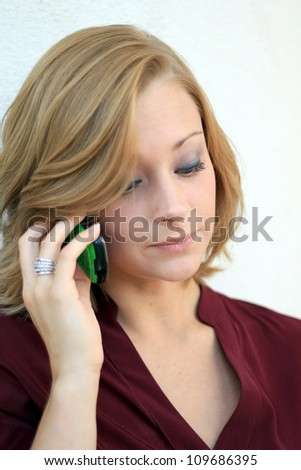 Attractive Professional Business Woman On the Phone While Looking Down - stock photo
