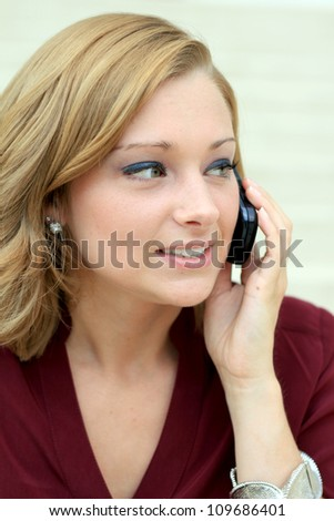 Attractive Professional Business Woman On the Phone While Looking to the Side - stock photo