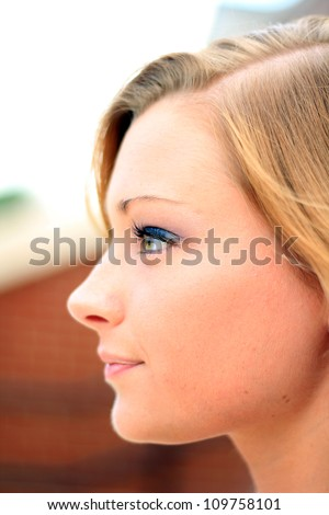 Attractive Professional Business Woman's Smiling Side Profile - stock photo