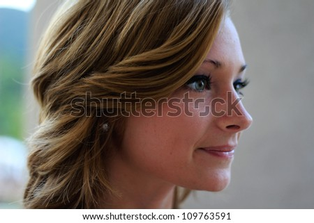 Attractive Professional Business Woman Smiling Looking To the Side Close Up - stock photo