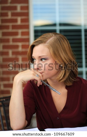 Attractive Professional Business Woman Thinking and Planning - stock photo