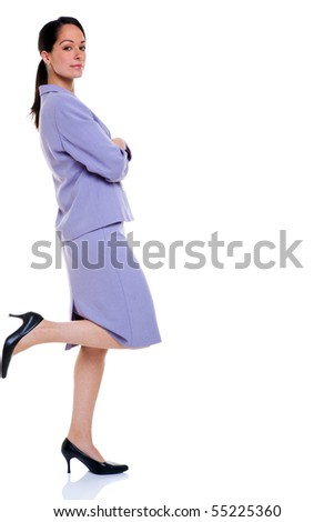 Attractive professional business woman with her foot up resting against the side, isolated on a white background. - stock photo