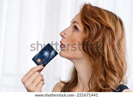 attractive red hair freckles woman with credit card - stock photo