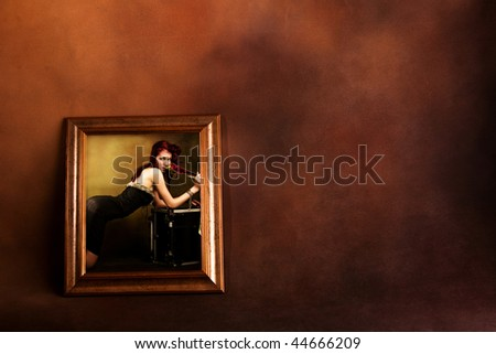 attractive red hair woman in frame - stock photo