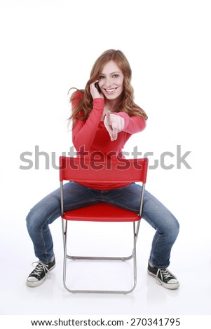 Attractive red haired woman doing a phone call