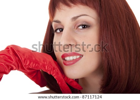 Attractive red- haired woman portrait in red glove