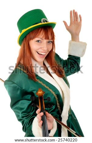 Attractive red haired young woman in traditional St Patrick holiday outfit. Studio shot.
