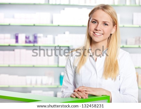Attractive saleswoman in pharmacy.