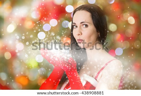 Attractive Santa girl blowing Christmas wishes  - stock photo