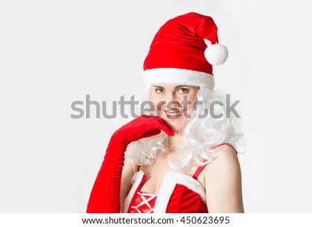 Attractive Santa girl smiling portrait. Christmas background