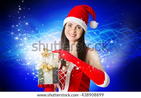 Attractive Santa girl smiling portrait with Christmas present. Christmas background - stock photo